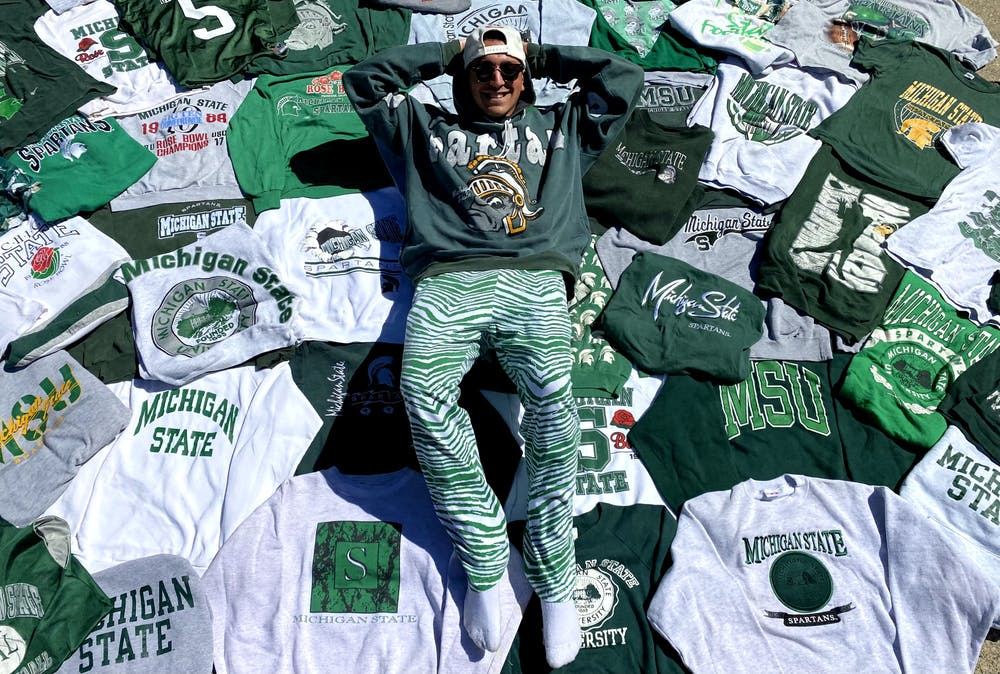 <p>Senior advertising management Jared Perlin lays in an assortment of his thrifted MSU vintage clothing that he&#x27;s collected over the years.</p>