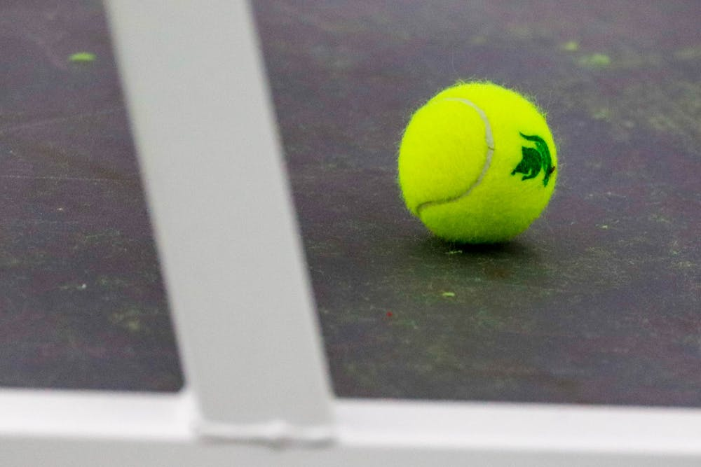 A tennis ball sits under a bench during the games against Niagara at the MSU Tennis Center on Jan. 25, 2020. The Spartans defeated the Purple Eagles, 7-0