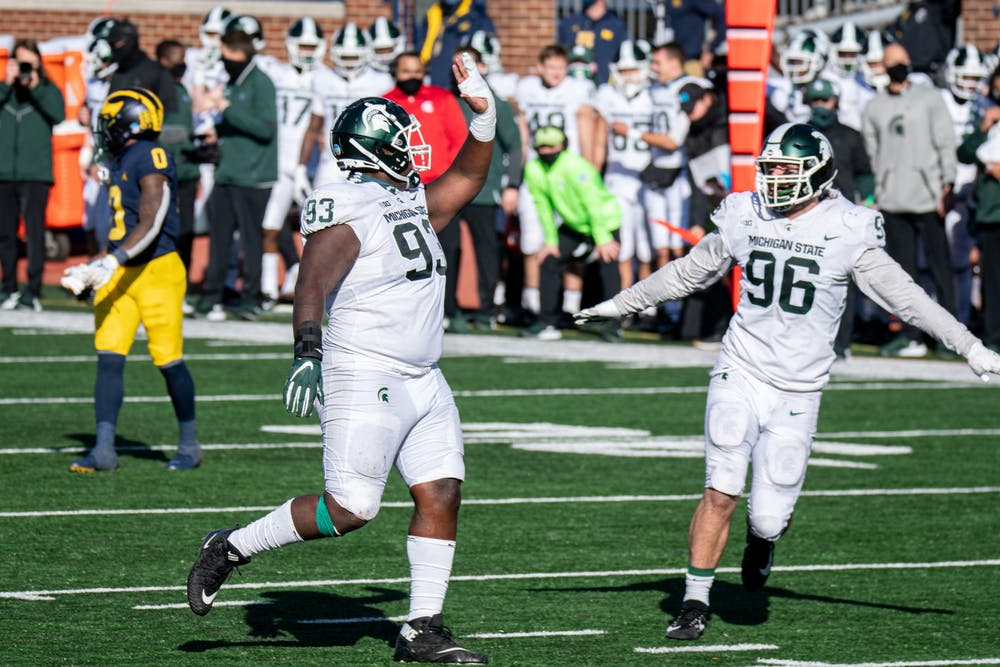 <p>Naquan Jones (93) celebrates with Maverick Hansen (96) near the end of a game against U of M on Oct. 31, 2020.</p>