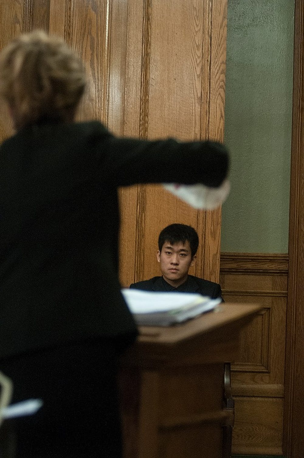 <p>Ingham County assistant prosecutor Kimberly Hesse holds up a plastic water pitcher while cross-examining MSU alumnus Meng Long Li Jan. 30 at 30th Circuit Court in the Ingham County Courthouse, 315 S. Jefferson St, Mason, Michigan. The water pitcher is a major piece of evidence involved in crimes that were committed Jan. 31, 2014, at Limit Pool &amp; Karaoke Club, 2800 E. Grand River Ave. and had been used to repeatedly beat the student who was attacked that evening. Allyson Telgenhof/The State News.</p>