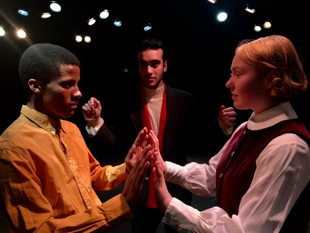 "<p>Actors in ""Thus With a Kiss I Die"" portray Romeo and Juliet in the fictitious Jekyll University's production of Shakespeare's play. Set in the American south in 1958, the interracial casting creates tension at the university and mayhem ensues. (Left to right) Evan Phillips, Raied Jawhari and Jamie Lien (Photo by Teriah Fleming)</p>"