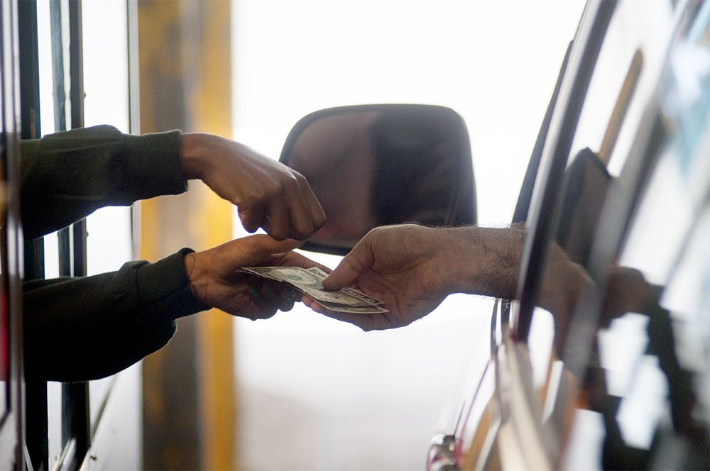 <p> A person pays for their parking bill at the City of East Lansing parking garage near 181 Division Street on June 30th, 2015. Joshua Abraham/ The State News</p>