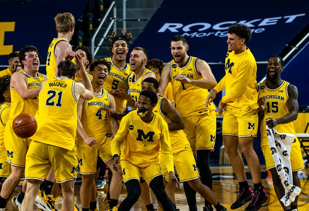 Michigan takes the title of Big Ten Champions after their win against Michigan State and the team celebrated together. The Wolverines crushed the Spartans, 69-50, at Crisler Center on Mar. 4, 2021.