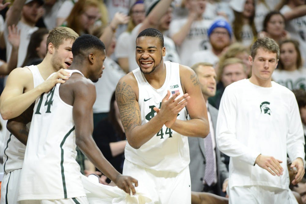 Freshman forward Nick Ward (44) reacts as senior guard Eron Harris (14) gets subbed in during the second half of men's basketball game against the University of Wisconsin on Feb. 26, 2017 at Breslin Center. The Spartans defeated the Badgers, 84-74.