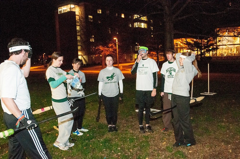 """<p>The <span class=""""caps"""">MSU</span> quidditch team talks before a scrimmage on Thursday, Nov. 15, 2012, at Wonder&#8217;s Hall. The team played a scrimmage for the Harry Potter world event put on by the Wonders Hall RA&#8217;s. James Ristau/The State News</p>"""