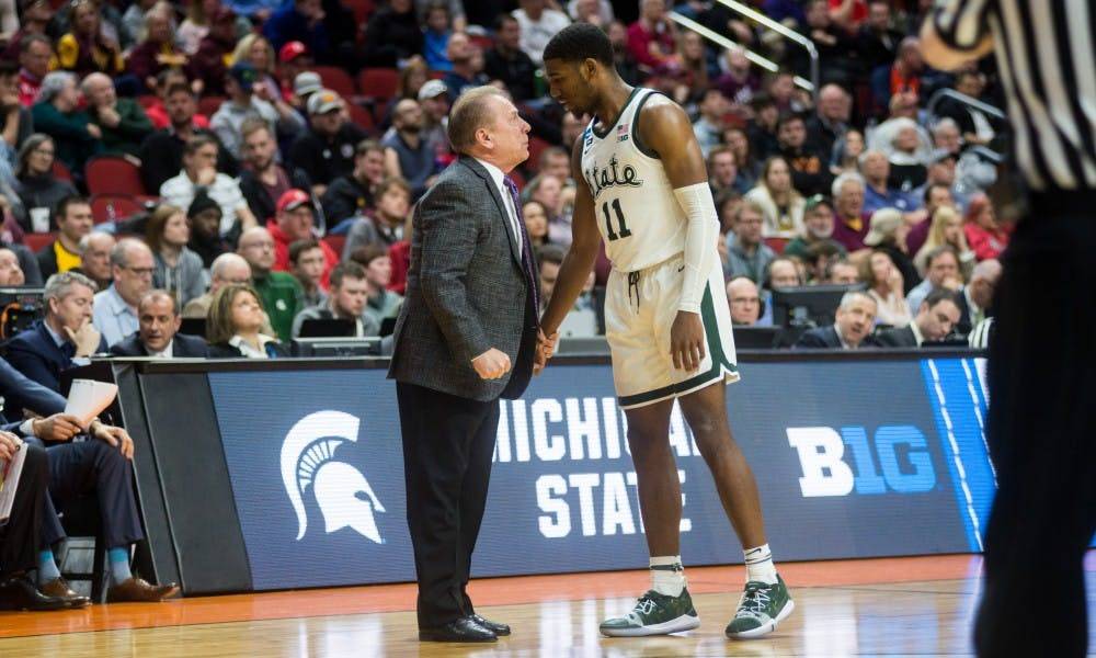 Head Coach Tom Izzo converses with freshman forward Aaron Henry (11) during the NCAA tournament game against Bradley at Wells Fargo Arena March 21, 2019. The Spartans defeated the Braves, 76-65.