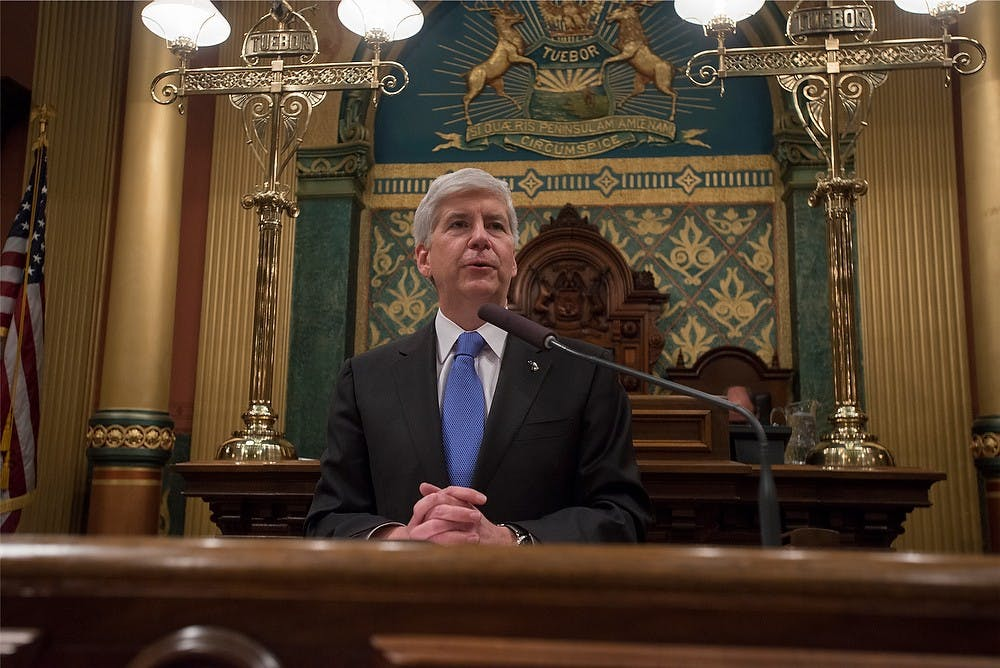 <p>Then-Michigan Governor Rick Snyder addresses the audience Jan. 20, 2015, during the State of the State Address at the Capitol in Lansing. Emily Nagle/The State News</p>