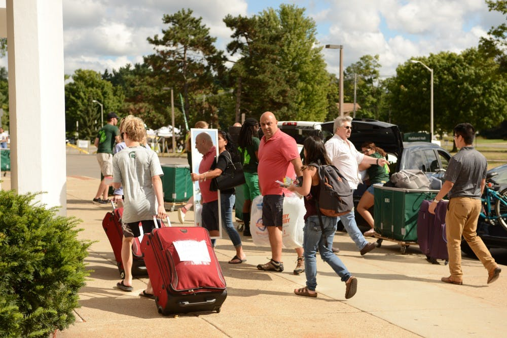 <p>Students and families move in to North Hubbard Hall during fall move-in day Aug. 25, 2019.</p>