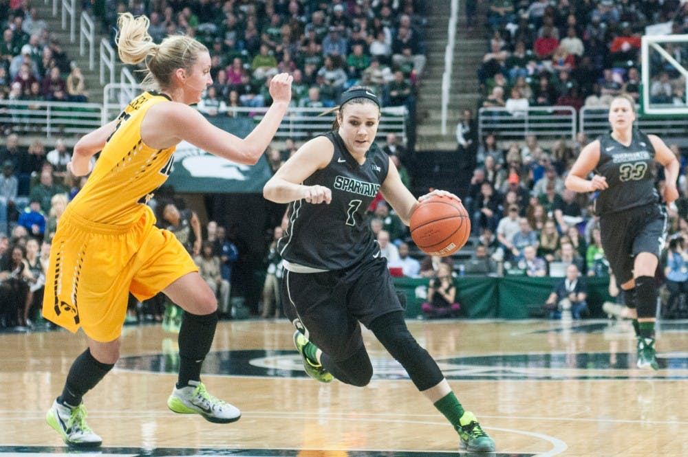 Junior guard Tori Jankoska fights past Iowa forward Kali Peschel during the first half of the game against Iowa on Jan. 16, 2016 at Breslin Center. The Spartans defeated the Hawkeyes, 80-73.