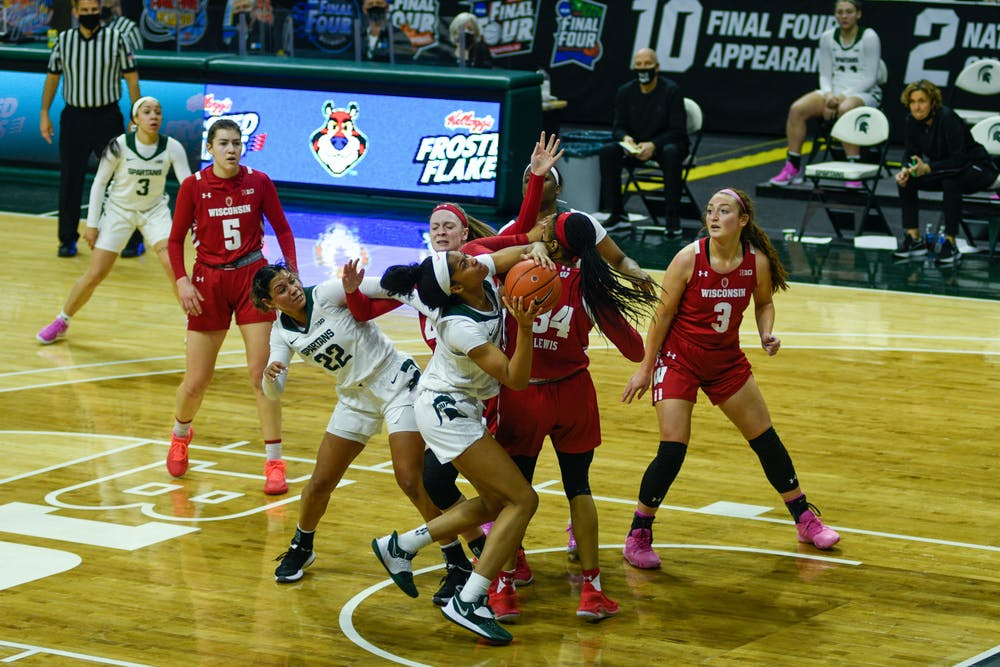 <p>Michigan State&#x27;s Alisia Smith (4) up against Wisconsin&#x27;s defense on the game in East Lansing on Saturday, Mar. 6 2021.</p>