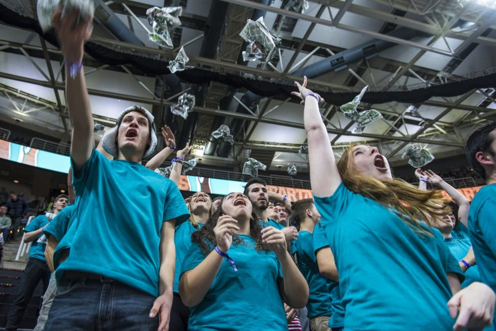 <p>Students in the IZZONE throw up newspapers before the men's basketball game against Wisconsin on Jan. 26, 2018 at Breslin Center. (Nic Antaya | The State News)</p>