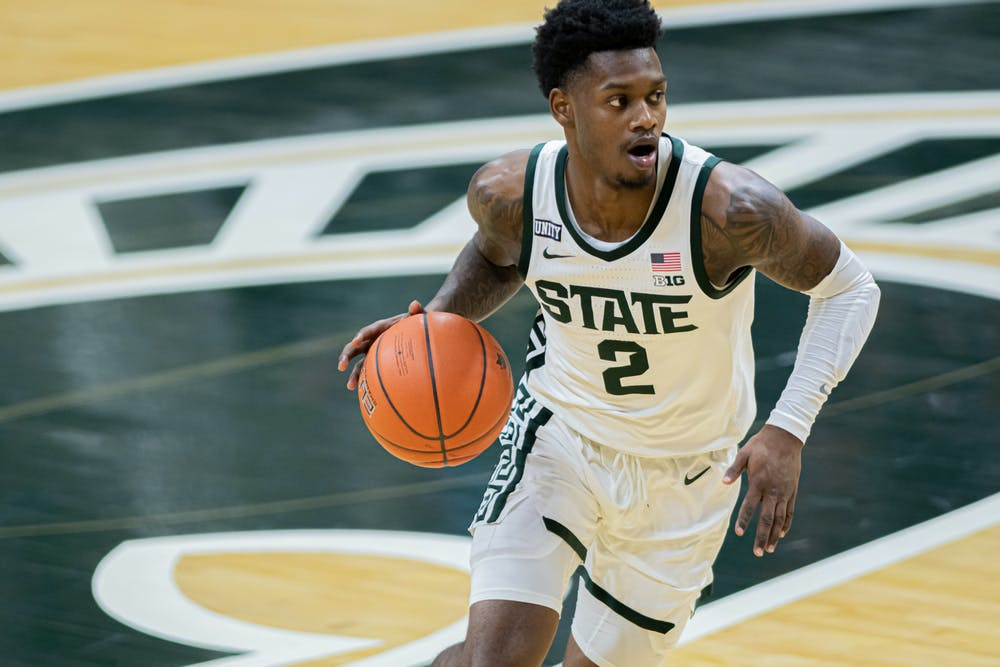 <p>Then-sophomore guard Rocket Watts pushes the ball up court during the Spartans&#x27; 70-64 upset against the No. 2 Wolverines on Mar. 6, 2021.</p>