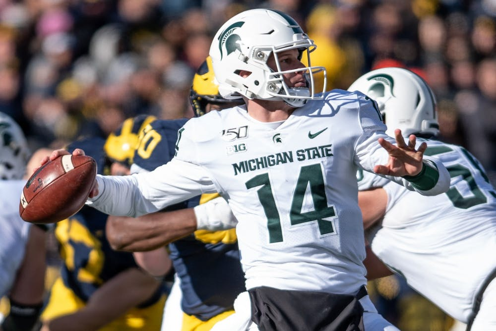 <p>Redshirt senior quarterback Brian Lewerke (14) throws a pass during the game against Michigan on Nov. 16, 2019 at Michigan Stadium. The Spartans fell to the Wolverines, 44-10.</p>