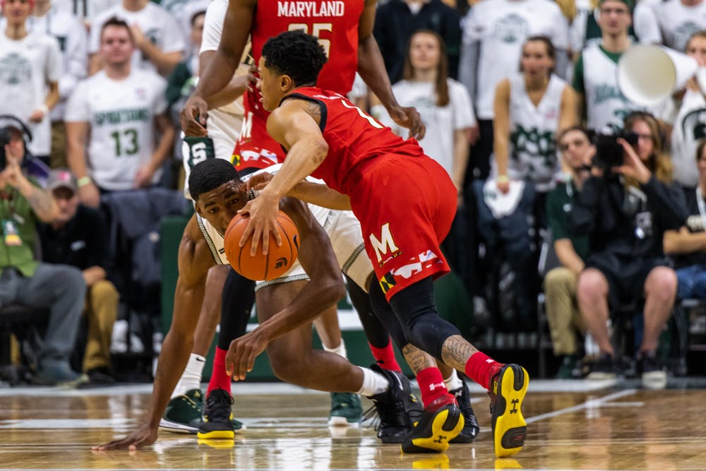 <p>Sophomore guard Aaron Henry (left) defends Maryland's Anthony Cowan Jr (right).</p>