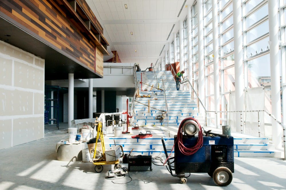 <p>Construction on the grand staircase in Brody Hall continues Friday, Aug. 13, as workers finish phase one of renovations. State News File Photo</p>