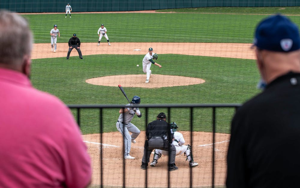 <p>Then-redshirt junior pitcher Mason Erla (30) throws a pitch for Penn State&#x27;s Johnny Piacentino in the fourth inning. The Spartans excelled against the Nittany Lions and won 7-4 at McLane Baseball Stadium on April 9, 2021.</p>