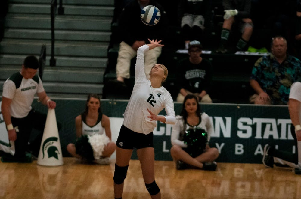 Junior setter Rachel Minarick (12) serves the ball during the game against Maryland on Oct. 8, 2016 at Jenison Field House.  The Spartans defeated the Terrapins, 3-1.