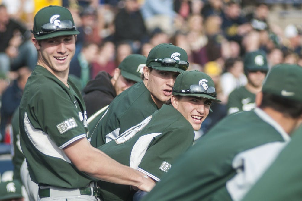 <p>Spartans laugh in the dugout during the game against University of Michigan on April 18, 2017 at Ray Fisher Stadium in Ann Arbor. The Spartans were defeated by the Wolverines, 12-4.</p>