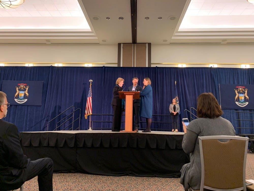 <p>Sen. Debbie Stabenow, D-Michigan, swears in Rep. Elissa Slotkin, D-Michigan, at a local swearing in ceremony on Jan. 13, 2019.&nbsp;</p>