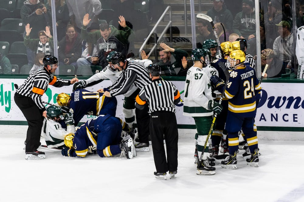 <p>Michigan State and Notre Dame players argue following a hit at the end of regulation. The Spartans tied with the Fighting Irish, 1-1, at Munn Ice Arena on Nov. 22, 2019. </p>