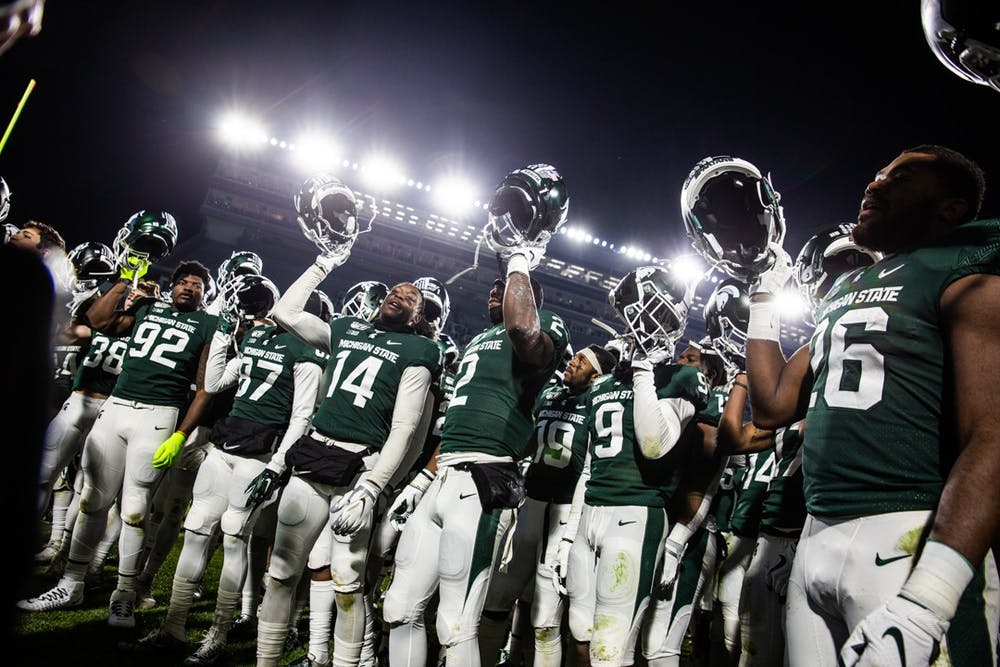 <p>Spartan football team members celebrate during the game Nov. 30, 2019, at Spartan Stadium. The Spartans beat the Terrapins 19-16.</p>