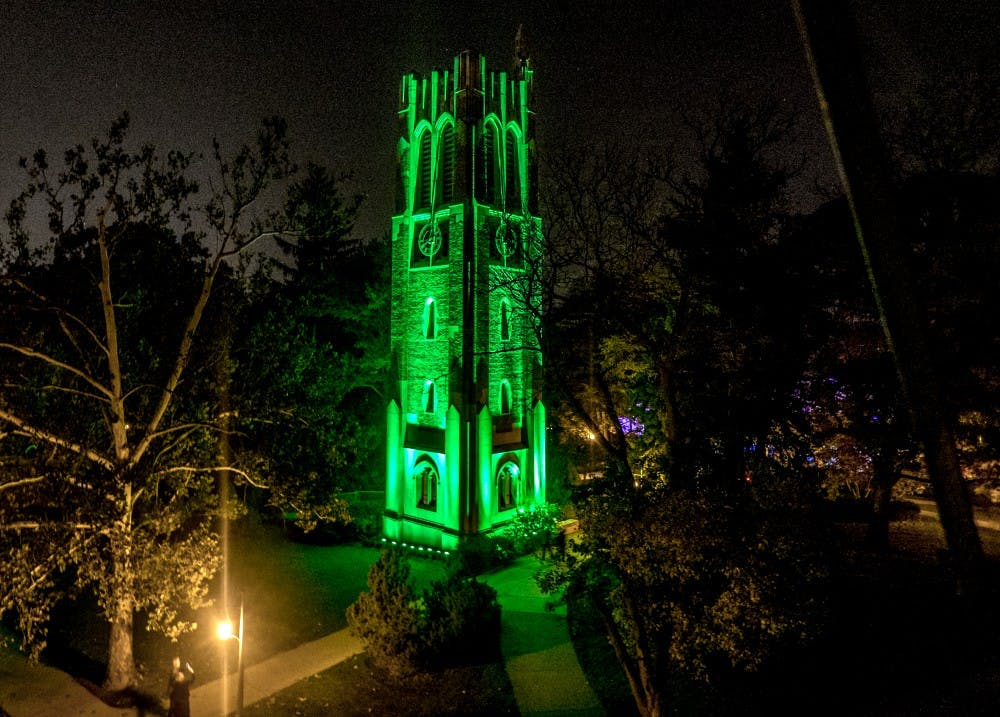 "<p>The Beaumont Tower is ""Glowing Green"" in honor of MSU homecoming week. Photo courtesy of MSU Photography Services</p>"