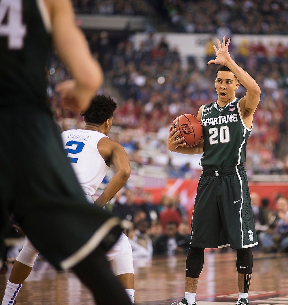 <p>Senior guard Travis Trice signals to his teammates April 4, 2015, during the semifinal game of the NCAA Tournament in the Final Four round at Lucas Oil Stadium in Indianapolis, Indiana. The Spartans were defeated by the Blue Devils, 81-61. Erin Hampton/The State News</p>