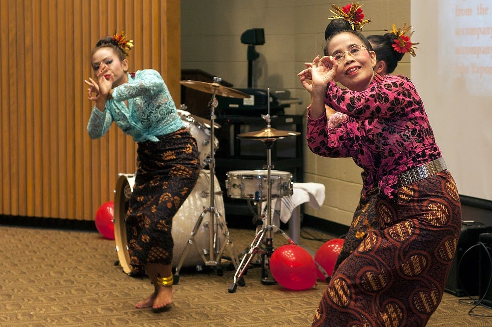 """<p>West Bloomfield, Mich., resident Ina Sanari, left, and Rochester Hills, Mich., resident Lani Krispin, right, do a traditional yapong dance Nov. 16, 2013, in the Erickson Kiva. The <span class=""""caps"""">MSU</span> Indonesian Student Association put on the 6th annual Indonesian Culture Night which shows traditional dancing, music and authentic foods.</p>"""