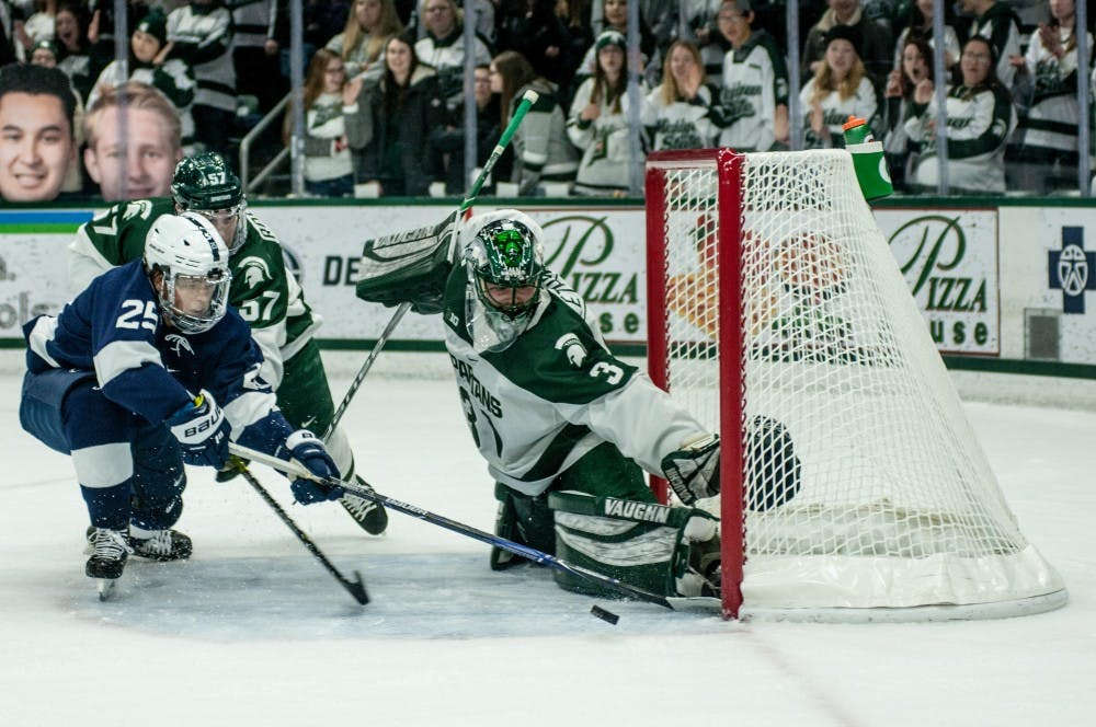 Junior goaltender John Lethemon (31) blocks a puck during the game against Penn State at Munn Ice Arena on Feb. 15, 2019. The Spartans defeated the Nittany Lions 5-3.