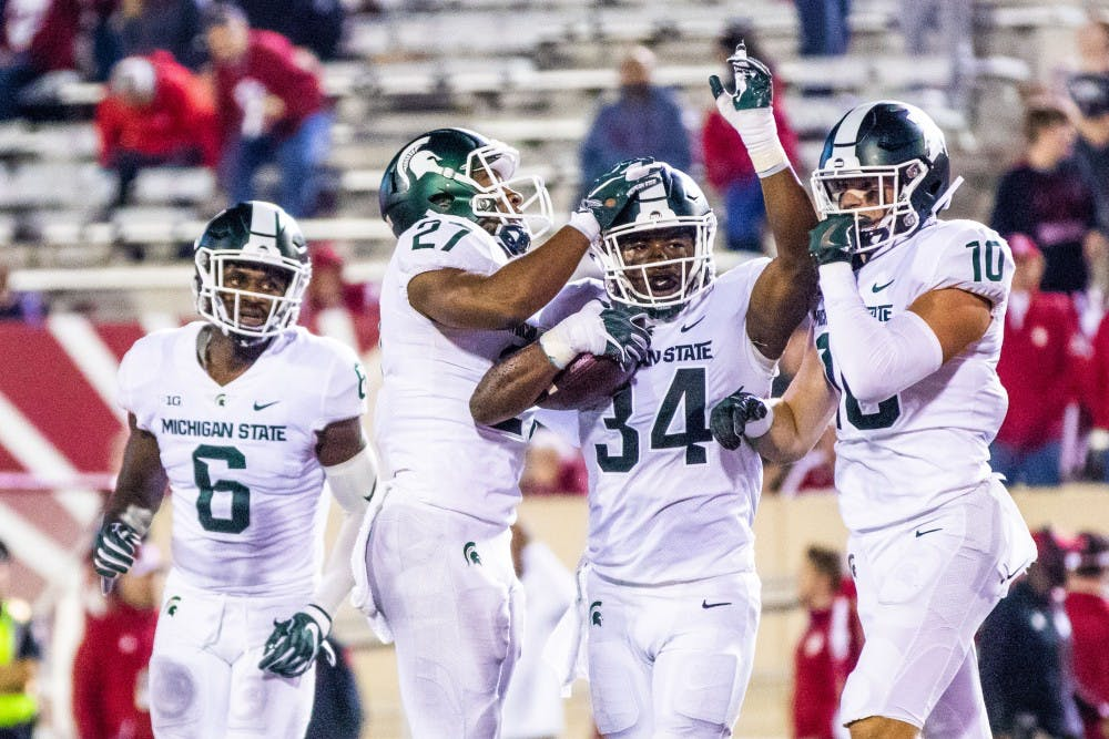 Sophomore linebacker Antjuan Simmons (34) celebrates a game-clinching interception during the game against Indiana on Sept. 22, 2018 at Memorial Stadium. The Spartans defeated the Hoosiers, 35-21.