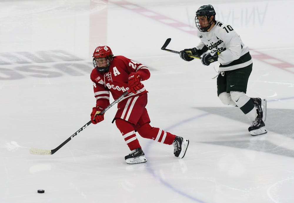 Senior Forward Sam Saliba (10) chases the puck during the game against Wisconsin at the Munn Ice Arena on December 6, 2019.  The Spartans defeated the Badgers 3-0.