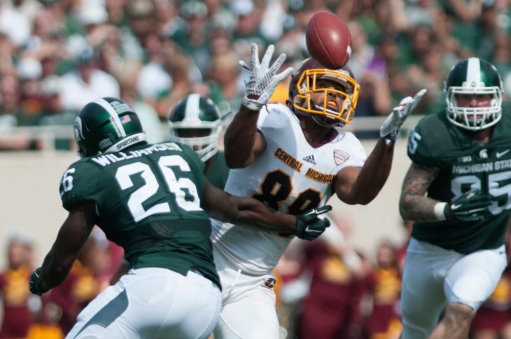 <p>Central Michigan tight end Ben McCord fails to complete a catch with pressure from senior safety RJ Williamson applied on him in the second quarter during the game against Central Michigan on Sept. 26, 2015, at Spartan Stadium. The Spartans defeated the Chippewas, 30-10. Julia Nagy/The State News </p>