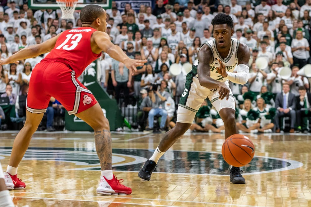 <p>Freshman guard Rocket Watts (2) passes the ball during a game against Ohio State.</p>