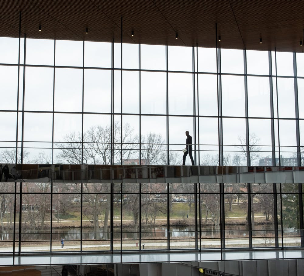 <p>A student walks through the Eppley Center after an email is released on March 11 notifying students that classes have been canceled due to growing concerns of COVID-19. </p>
