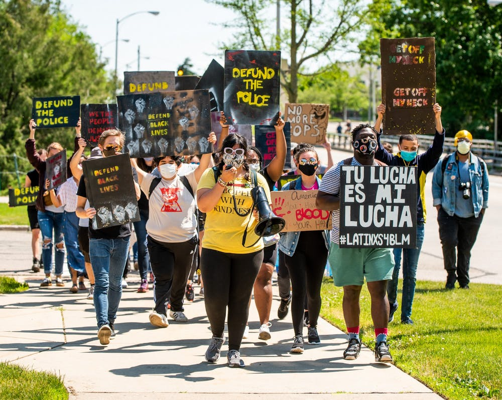 A crowd of mostly students walks to ELPD from MSU for a die-in protest June 12, 2020.