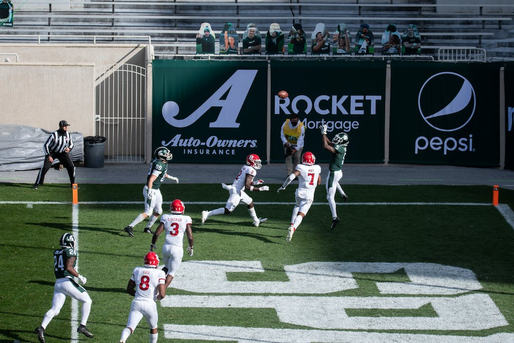 Wide reciever Jayden Reed, 5, from Naperville, IL earns a touchdown  for MSU in the second half of a game against Rutgers on Oct. 24, 2020.