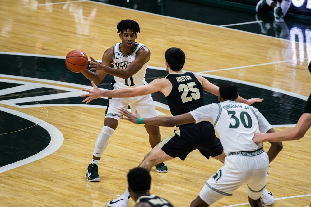 <p>Freshman guard A.J. Hoggard passes the ball during the Spartans&#x27; 55-54 loss to Purdue on Jan. 8, 2021.</p>