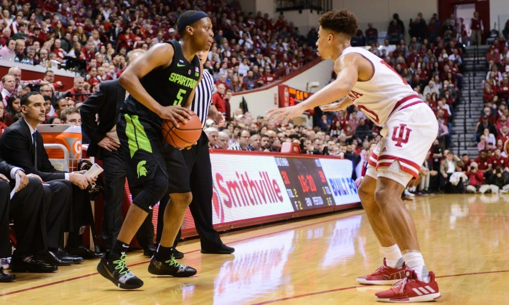 <p>Junior point guard Cassius Winston (5) looks for an open pass during the game against Indiana at the Bloomington Assembly Hall Mar. 2, 2019. The Spartans fell to the Hoosiers, 63-62.</p>