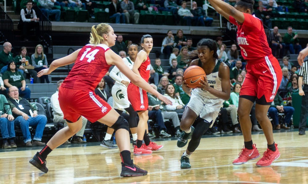 <p>Freshman guard Nia Clouden (24) drives for a layup against Ohio State. The Spartans lost to the Buckeyes, 70-77, Feb. 21, 2019 at the Breslin Center.</p>