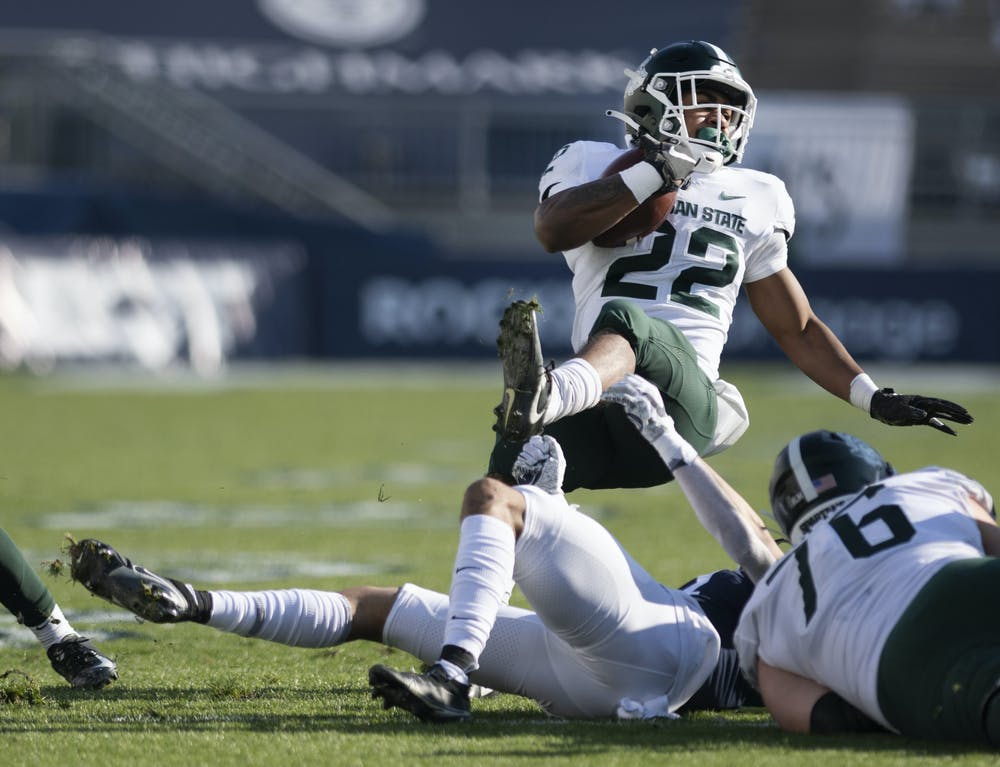<p>Cornerback Keaton Ellis (2) brings down Michigan State running back Jordon Simmons (22) during Penn State football's game against MSU on Saturday, Dec. 12, 2020, in Beaver Stadium. Penn State won 39-24. Photos courtesy of Lily LaRegina, photographer and photo editor at The Daily Collegian.</p>