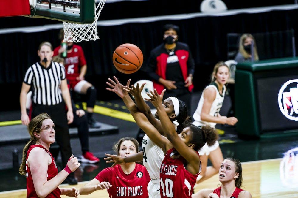 <p>Alisia Smith and Christina Nichols attempt to catch a rebound on Nov. 27, 2020.</p>