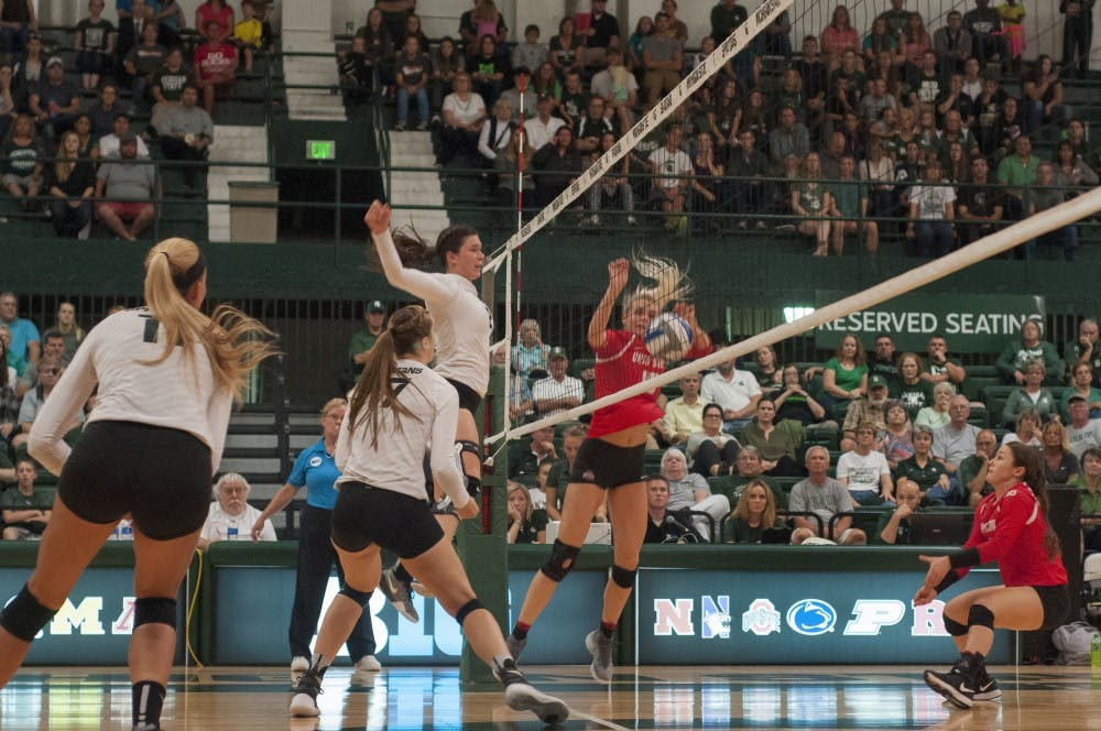 From left, senior outside hitter Chloe Reining (11), junior middle blocker Alyssa Garvelink (17) and redshirt junior outside hitter Autumn Bailey (2) watch the ball during the game against Ohio State University on Oct. 7, 2016 at Jenison Field House. The Spartans defeated the Buckeyes 3-0.