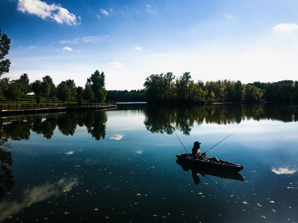 Antonio Alicea of Lansing waits for a catch while sitting in his kayak on Sept. 18, 2017 at Hawk Island County Park at 1601 E. Cavanaugh Rd. in Lansing.