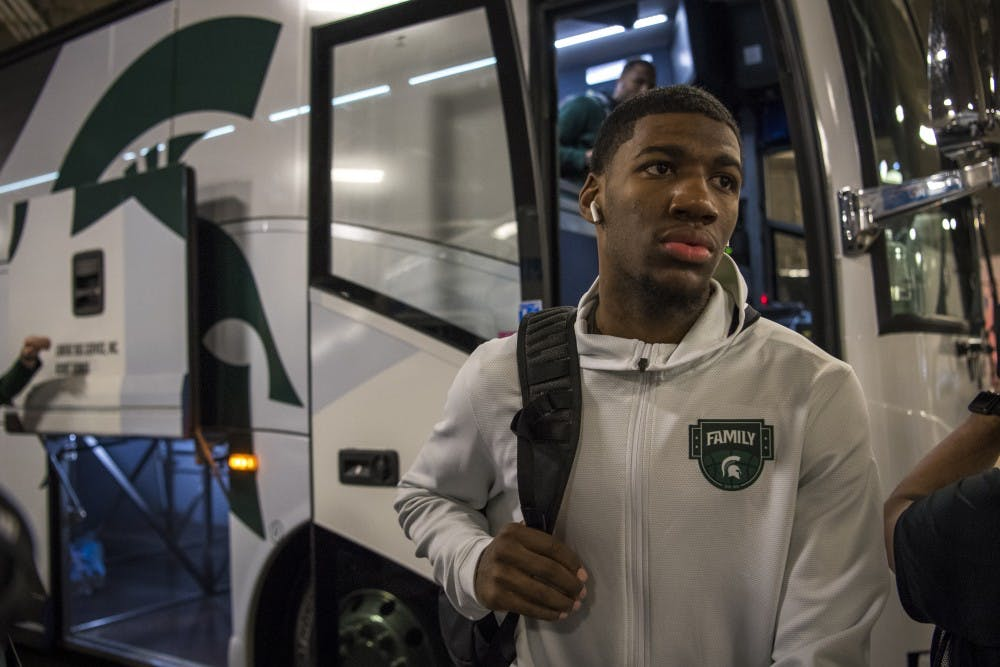<p>Freshman forward Aaron Henry (11) walks off the bus as the men&#x27;s basketball team arrives to U.S. Bank Stadium before their NCAA Final Four game against Texas Tech in Minneapolis on April 6, 2019. (Nic Antaya)</p>
