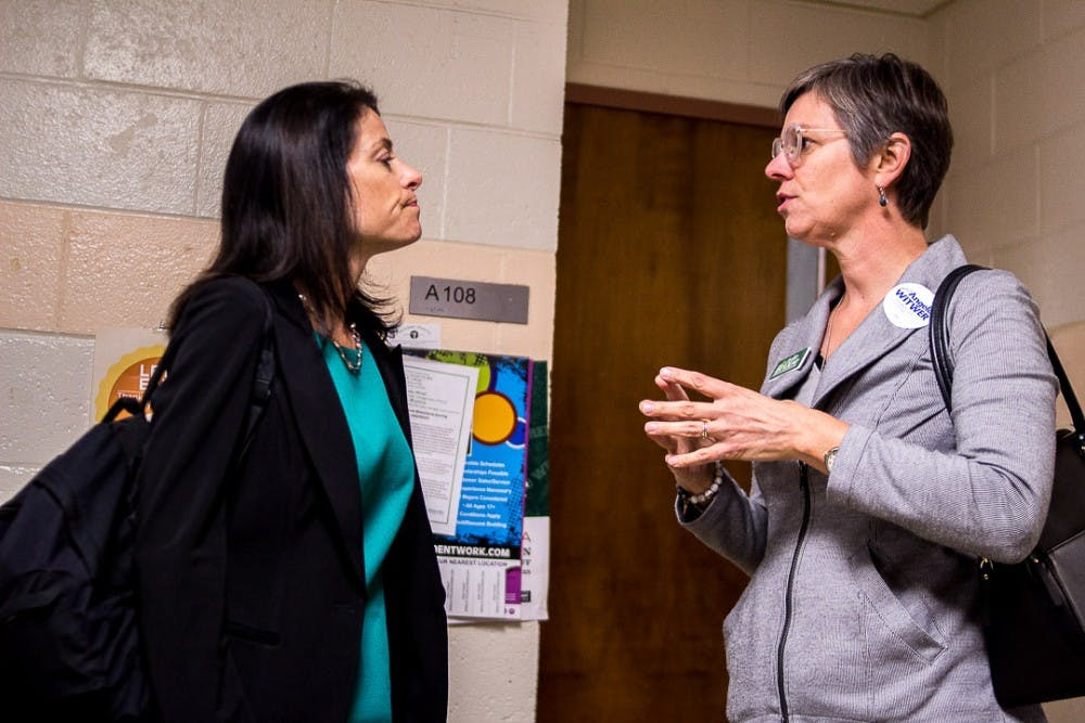 <p>Democratic nominee for attorney general Dana Nessel listens to Democratic nominee for state representative Julie Brixie on Oct. 22, 2018 at Wells Hall. Nessel is running for Michigan attorney general in the upcoming election.</p>