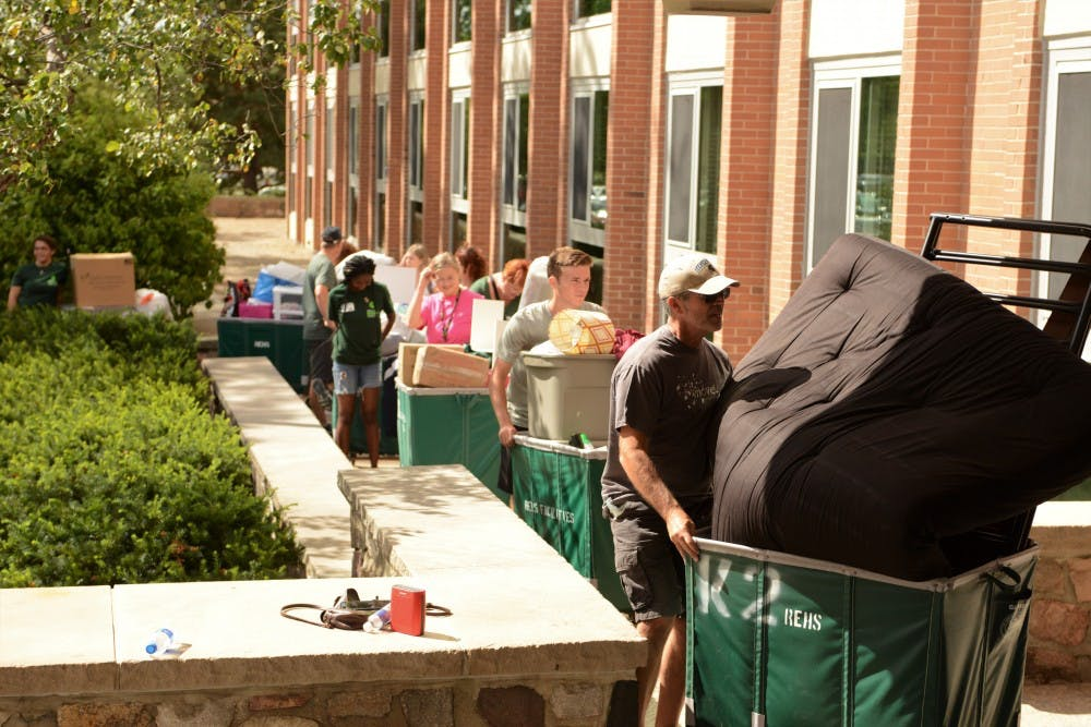<p>Families of new and returning students waiting in line to move in to South Hubbard Hall during Fall move in day on Aug. 25, 2019.</p>