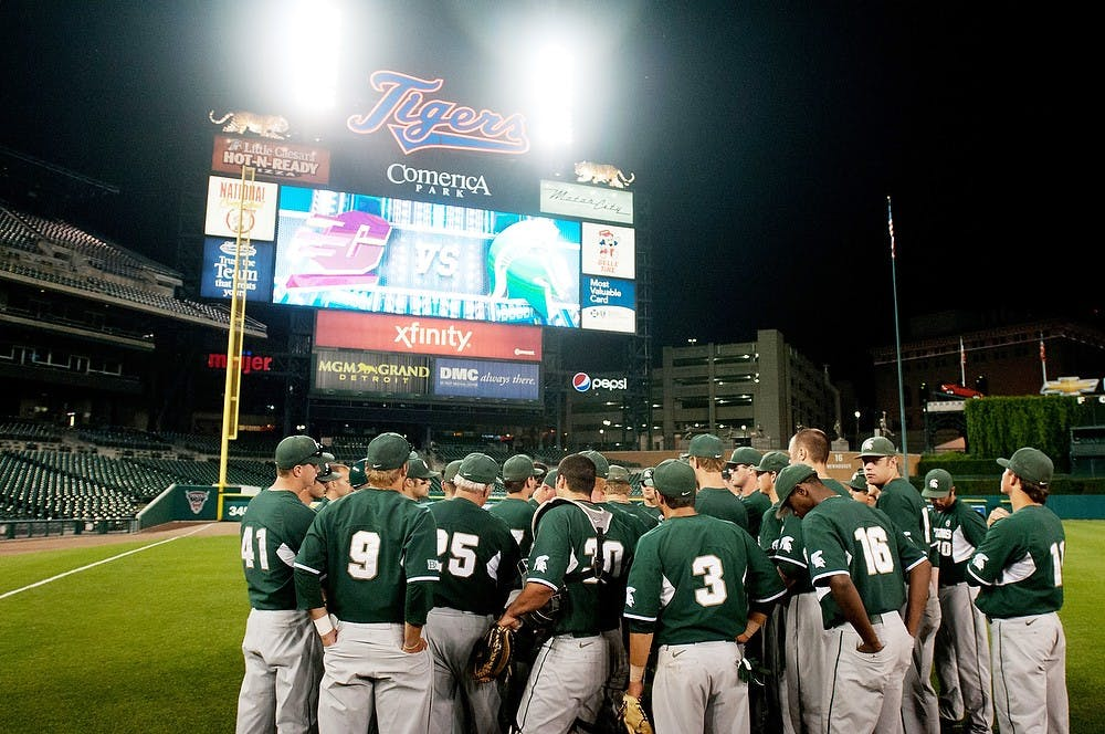 <p>The Michigan State baseball team gathers in the outfield after defeating Central Michigan Tuesday, May, 15, 2012, at Comerica Park in Detroit. The Spartans defeated the Chippewas, 5-2. State News File Photo</p>