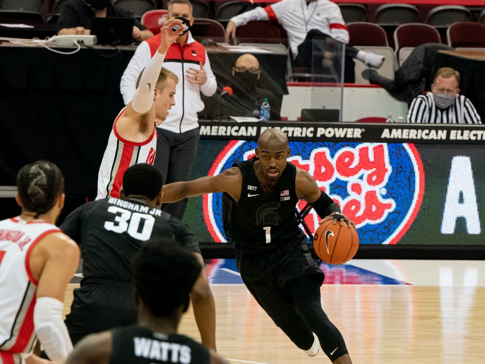 <p>Joshua Langford communicates with his teammates Rocket Watts and junior forward Marcus Bingham Jr. (30) during the first half of the game. The Buckeyes swept the Spartans, 79-62, at OSU&#x27;s Schottenstein Center on Jan. 31, 2021.</p>