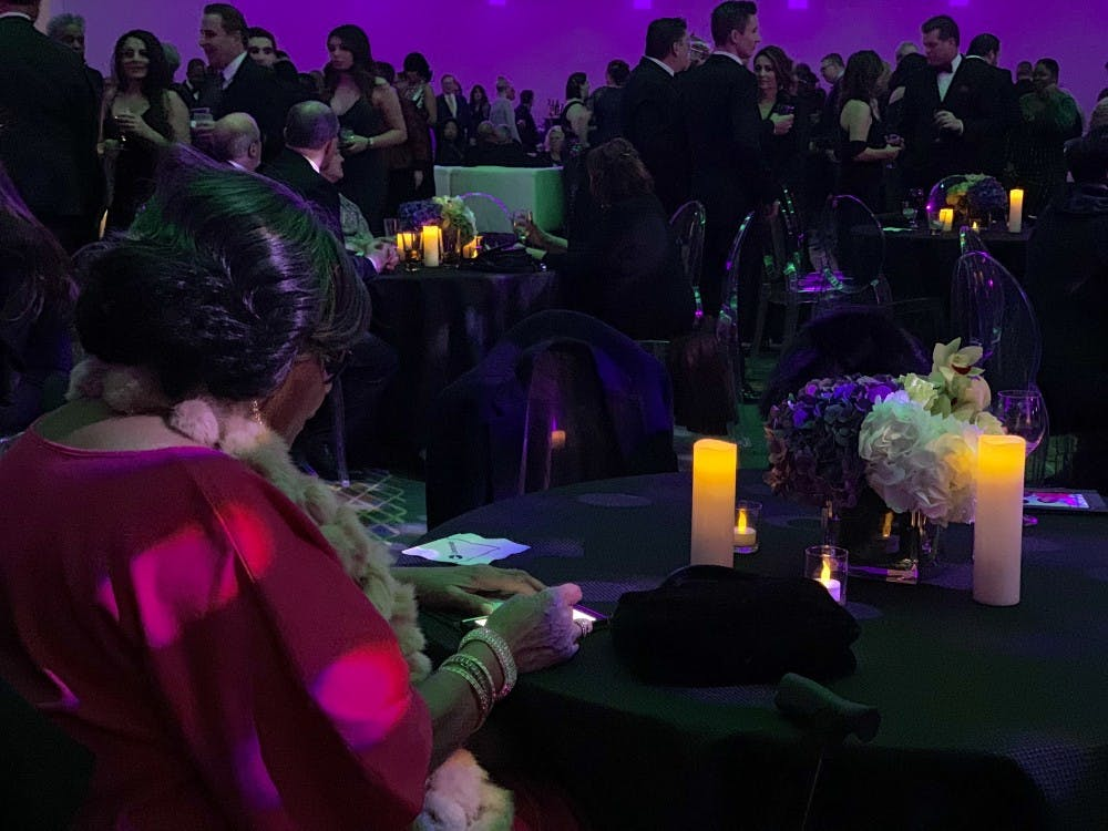 <p>A supporter sits at a table at Gov. Gretchen Whitmer's inaugural celebration at the Cobo Center in Detroit Jan. 1, 208.&nbsp;</p>
