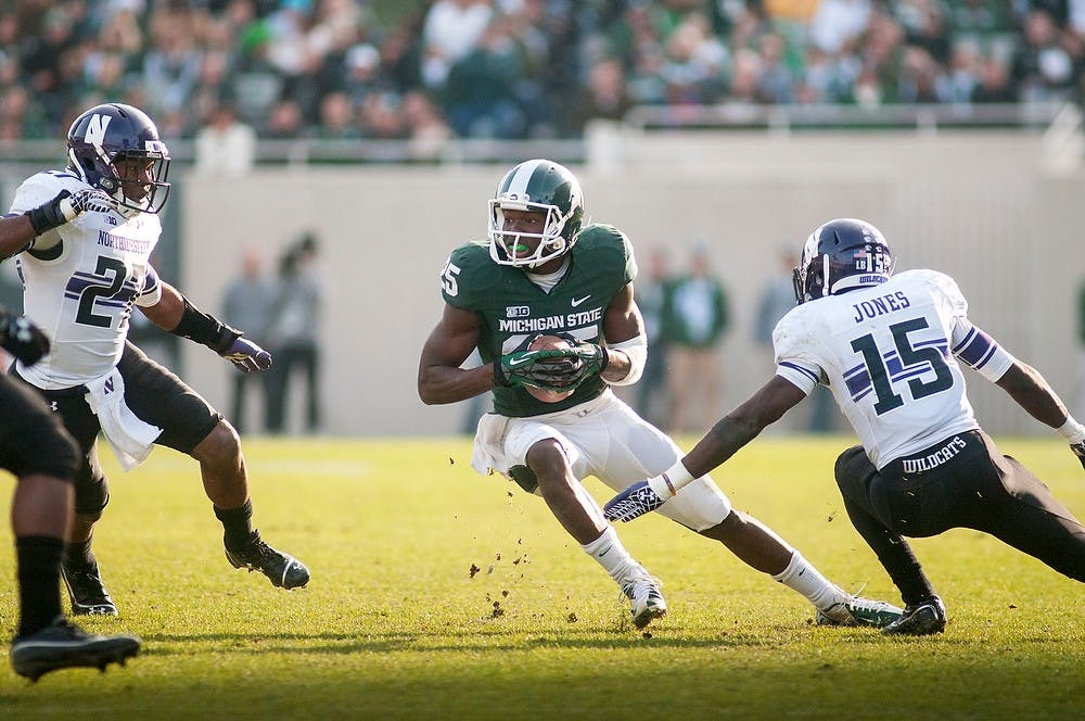<p>Sophomore wide receiver Keith Mumphery dodges cornerback Daniel Jones on Saturday, Nov. 17, 2012, at Spartan Stadium. Mumphery finished the game with 79 receiving yards in the Spartans&#8217; 23-20 loss to Northwestern. James Ristau/The State News</p>